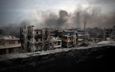destroyed-and-abandoned:  Smoke rises over a battle-scarred Saif Al Dawla district in Aleppo, Syria, on October 2, 2012Source
