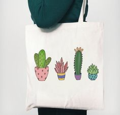 Cute cactus design bag.  The bags measure 42 x 38cm, the handles are 33cm from the top of the bag to the top of the handle.  Please allow up to 3