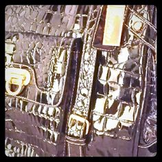 Patent Leather Crocodile Purse Saldino purse from UK in EUC. Unique closure. Shiny black crocodile patent leather with gold accent. Very roomy and you will not see another bag like this anywhere. Minor wear on handles. Message for more info. Saldino Bags Shoulder Bags