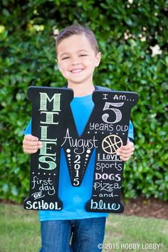 Forever remember your little one's first day of school with a keepsake that's all about them!  1.) Take sandpaper and sand the rough edges of the letter and the top surface. Tip: wipe all of the dust off when done. 2.) Paint your letter with black chalk paint covering the entire top surface and the edges of the letter. Tip: let dry a few hours. 3.) Take a regular pencil or chalk pencil to draw out your words and designs of choice. 4.) Trace over your words with chalk markers.