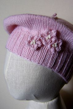 Ravelry: a beret for baby... pattern by pamela w allen    I am knitting this for baby girl, not sure about the flowers, I might use buttons !!!