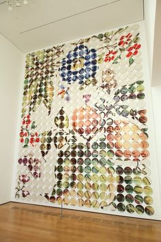 """Artist Molly Hatch creates ceramic """"plate paintings"""" in which patterns and illustrations are distributed across multiple ceramic plates. Some of the installations are quite large: Physic Garden is ..."""