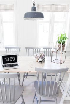 Ive always loved this chair style... grey, wood and white dining room | photo: anetteshus