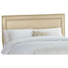 Nailhead-trimmed headboard with pine wood frame. Handmade in the USA.     Product: HeadboardConstruction Material:  Micro-suede and pine woodColor: Premier oatmealFeatures:  Nailhead button borderWill provide any bedroom with instant charm and cozinessDimensions: Twin: 52'' H x 41'' W x 4'' DFull: 52'' H x 56'' W x 4'' DQueen: 52'' H x 62'' W x 4'' DKing: 52'' H x 78'' W x 4'' DCalifornia King: 52'' H x 74'' W x 4'' D