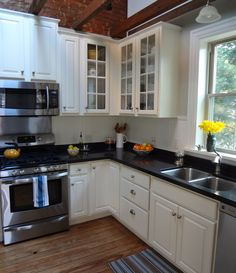 After: The paned glass doors in corner help this 11x11 kitchen feel spacious and airy.