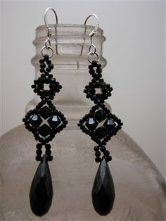 Marcia Decoster Designs | In Black, Crystal Red Magma with long drops, Olivine, Crystal Red ...