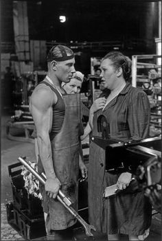 A worker and female supervisor chatting at The ZIS factory, Moscow, 1954 by Henri Cartier-Bresson