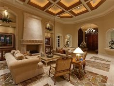 Traditional living room - stone fireplace - stone floor - ceiling. Il Corsini   Mediterra   Naples, FL