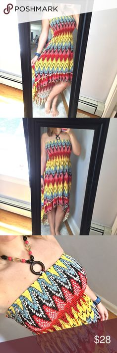 """Beautiful high low dress - Size: M - Material: 96% polyester, 4% lycra  - Condition: excellent - Color: red, yellow, blue, white, black  - Pockets: no - Lined: no - Closure: none, very stretchy to get on - Style: high low halter dress with pretty neck piece  - Extra notes:   *Measurements: ✨Very stretchy dress, keep that in mind✨ Bust: 12.5"""" flat Waist: 16"""" flat Length: 30.5"""" in front, 46.5"""" in back Magic Dresses High Low"""