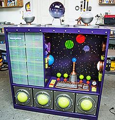 The Domestic Curator: REINVENT, REPURPOSE & RECYCLE: Entertainment Centers WHAT TO DO WITH THAT OLD UGLY ENTERTAINMENT CENTER CLUTTERING UP YOUR GARAGE!  An International Space Station!