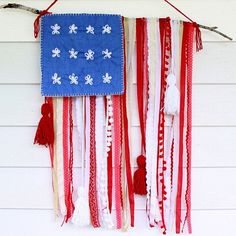 A DIY flag Made From Twig and Ribbons