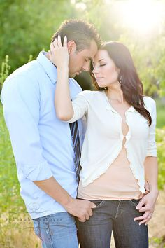 Beautiful pose of a couple with gorgeous natural light. Sincere and natural. Love his fingers in her pockets as well.