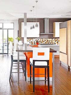 A citrus-inspired orange island adds excitment to a neutral space. See more colorful kitchen islands: http://www.bhg.com/kitchen/island/colorful-kitchen-islands/?socsrc=bhgpin041014orangeisland