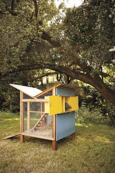 The Chick-in-a-Box chicken coop features a butterfly roof that funnels rainwater, a cabinet-style nesting box with sliding doors, a ladder and a front door that folds down to a ramp.