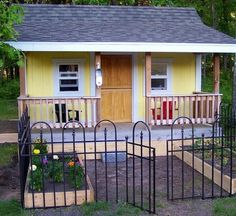 The most precious playhouse ever!  ~love the adorable garden gate maybe on the side? Or two in the front!!