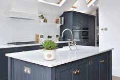 A beautiful deVOL Shaker Island painted in Pantry Blue with Bella Brass knobs and a Carrara Marble worktop. This shot was sent in by one of our lovely customers