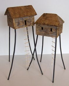 Jungle huts by Elly van de Merwe - small huts on high poles, inspired by Papua New Guinea.