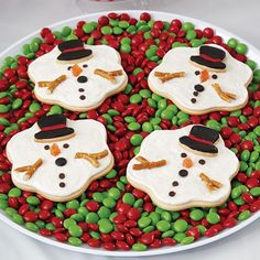 Melted Snowman Cookies Will Melt Their Hearts - Just like the melting snow in spring, these melted snowman cookies will be gone before you know it! They're easy to make, using the Wilton® Melted Puddle Snowman Cookie Cutter Set to cut the snowman and hat shapes and Icing Pouches with Tips to add the fun details.