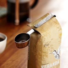 A coffee scoop with a beautiful hammered clip that attaches to your coffee bag.