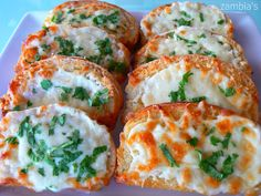 Kitchen Stories: Garlic Crostini with Mozzarella Garlic Baked Potatoes, Kitchen Stories, Mozzarella, Finger Foods, Recipies, Appetizers, Cheese, Meals, Baking