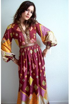 Vintage - Amazing dress, and DEADSTOCK vintage. Lovely billowy long sleeves and plunging neckline. Divine!