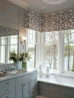 Love the window treatment   I like the way the tub is situated