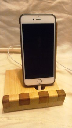 A personal favorite from my Etsy shop https://www.etsy.com/listing/250961725/wooden-phone-charging-stand