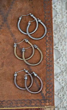 "Wirework earrings in three metals. Coils made using the Twist Again link from ""The Missing Link"" by Cindy Wimmer. Copper Jewelry, Wire Jewelry, Jewelry Crafts, Jewelery, Beaded Jewelry, Jewelry Ideas, Guitar String Jewelry, Bead Studio, Wire Earrings"