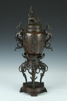JAPANESE BRONZE CENSER, Meiji Period. Bird and floral decoration, the cover with shi-shi finial - 19 in. high.