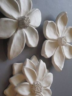 This wall are includes three attractive ceramic flowers
