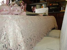 "Victorian at Heart: Gail's ""Rachel Ashwell"" Inspired tablescape using a pink crocheted tablecloth over a cream lace tablecloth"