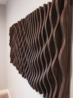 This parametric wall wave is a visually intriguing piece of wall art. Comprised of 47 individually cut pieces of cabinet grade oak plywood that spaces apart to displays a sweeping and organic parabolic wave. This piece is 58 long, 28 wide, and 3 thick Wooden Wall Art, Wooden Walls, Wooden Wall Panels, Wood Sculpture, Wall Sculptures, Art Cabinet, 3d Wall Art, Art 3d, Diy Wood Wall