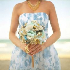 Fabric bouquet. Coordinate the fabrics of your bridesmaid dresses, table cloths, photobooth backdrops – you name it and tie your bouquet into your big day