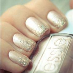 Neutral metallic + glitter tips.