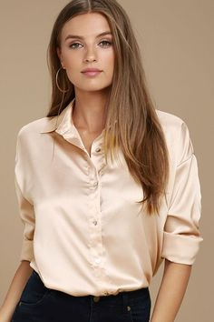 Dressed up or down, you can always count on the Sheen on Me Blush Satin Button-Up Top! Silky satin fabric forms this classic button-up top with a collared neckline, full button placket, and a relaxed bodice. Notched hem.