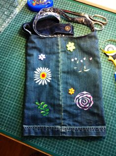 Upcycled denim embroidered shoulder bag. Fully lined.
