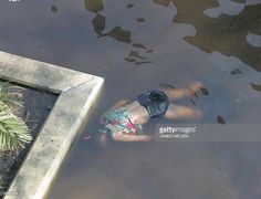 A body floats outside the Superdome in New Orleans, Louisiana in the aftermath of Hurricane Katrina 02 September 2005.