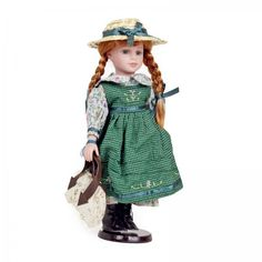 Bring home a kindred spirit to play with and dress up! This 16'' Anne of Green Gables, pose-able vinyl doll is perfect for any playtime or tea party. Anne's miniature replica carpet bag is removable, along with her straw hat, and shoes. Doll's body is made of durable cloth, while arms, legs and face are vinyl.
