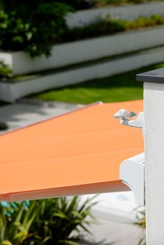 Motorized #awnings are always a great idea for outdoor fun! This orange awning features the Soliris Radio Technology Somfy® (RTS) combined sun and wind sensor, for complete protection!