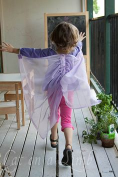 DIY wings. I have some old colorful sheer curtains that would be great to up-cycle to wings for my girls!