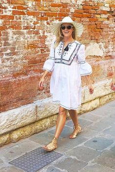Reese Witherspoon wearing Talitha Diamond-Embroidered Cotton Dress, Ace of Something Haliday Hat and Loeffler Randall Starla Sandals