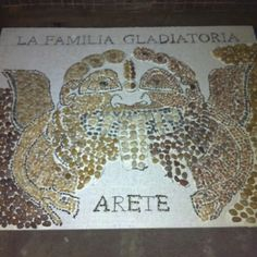 Gorgon, Day 9 I decided to work on the mosaic tonight instead of doing laundry. I think it was a good decision. I filled in the left wing, the curls on the left side of the head and the area under the nose. Oh, I also filled in the right eye and started the letters on the bottom. With the letters, I've started filling in every other one so I don't smudge the one next to it. Tomorrow I'll start on the lettering above the gorgon!