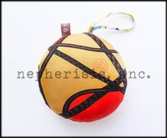 Hermes silk ball ornament or bag charm. New condition with box & ribbon.