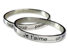 Inspired by Diana Gabaldon's Outlander series. Brianna's Bracelet  Bangle reads in French:  Je t'aime . . .  un peu  . . . beaucoup . . . passionnément  . . .  pas du tout . . .  Translation:   I Love you ... a little ... a lot ... passionately ... not at all.