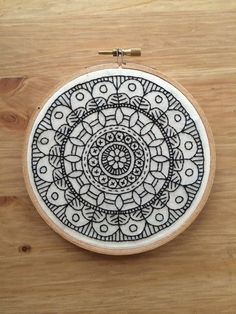 This hoop is one of a kind original, only one will be made. Available I have a hand embroidered mandala with black thread on cotton fabric.