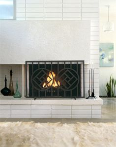 Firescreen - Keso    • Hand crafted iron firescreen.   • Custom size available  • weight 45 lbs  • Powder Coat in black  • Metal Mesh Backing