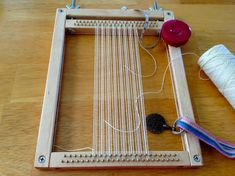 Hand-built miniature tapestry loom, size of an iPad, for travel. - simple tensioning device at top