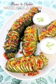 Loaded like a baked potato with sharp cheddar cheese, crumbled bacon, green onions and sour cream. Bacon and Cheddar Hasselback Zucchini Low Carb Recipes, Cooking Recipes, Healthy Recipes, Zucchini Muffins, Zucchini Cheese, Stuffed Zucchini, Zucchini Aubergine, Vegetable Recipes, Side Dishes