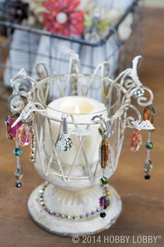 Add beads, crystals and bits of white lace to a stark wire votive holder, and you have a look that crosses romance with utility—and it works.