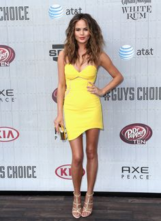 Chrissy Teigen Wearing Three Floor label yellow mini dress at an event in L.A.   - ELLE.com
